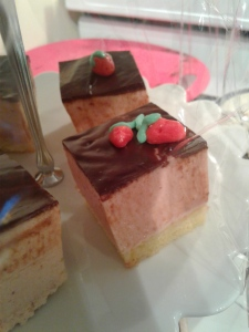 strawberry mousse cake, piece of cake with three flavors, vanilla, strawberry and chocolate