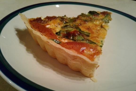 Piece of spinach sausage quiche