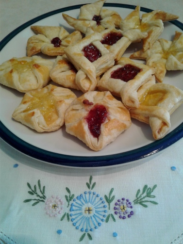 Plate of puff pastries with raspberry and apricot jam