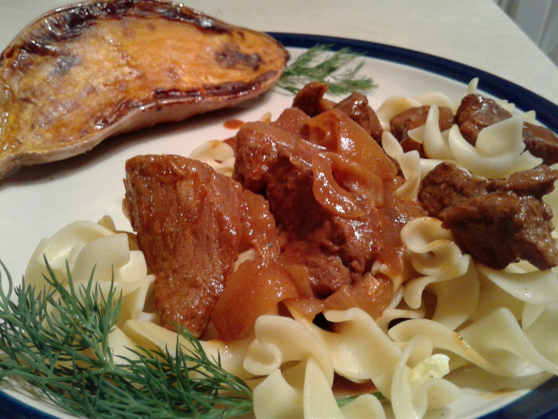Hungarian beef with egg noodles and roasted sweet potato on the side