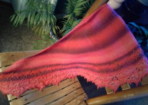 Lace alpaca merino wool hand knit shawl in red tones