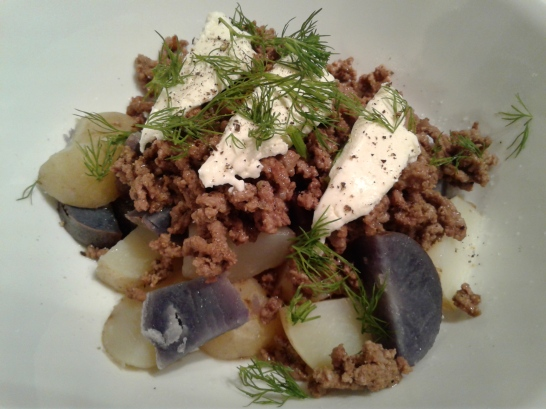 Purple and white potatoes with ground beef and sour cream