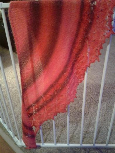 Alpaca yarn lace shawl in red-tone stripes