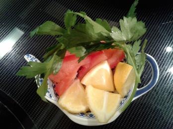 Parsley, lemon, and tomato garnishes