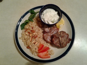 Plate with lamb chops, brown rice, and cucumber yogurt sauce
