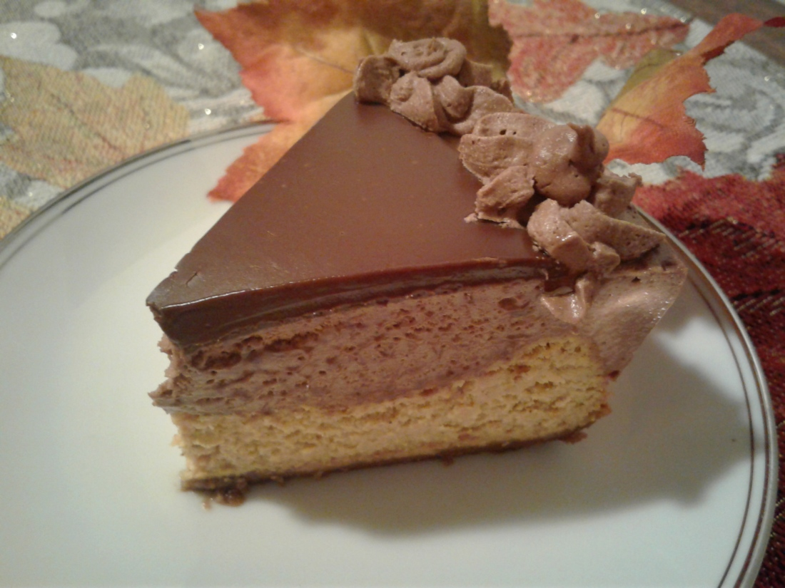 Piece of pumpkin cheesecake with chocolate mousse and dark chocolate ganache