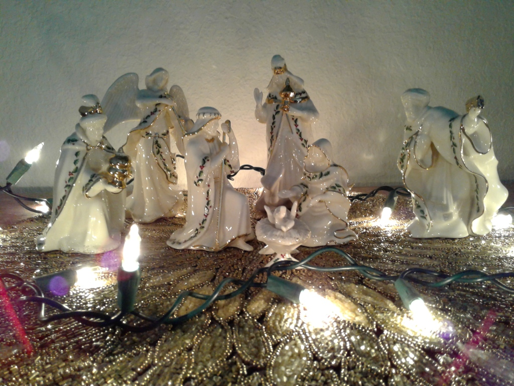 Nativity with white ceramic figurines and white lights