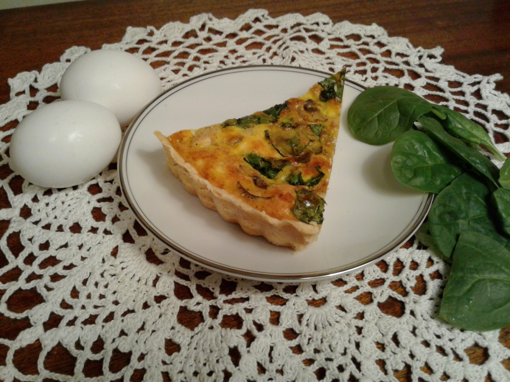 Quiche with chicken, mushrooms, and spinach
