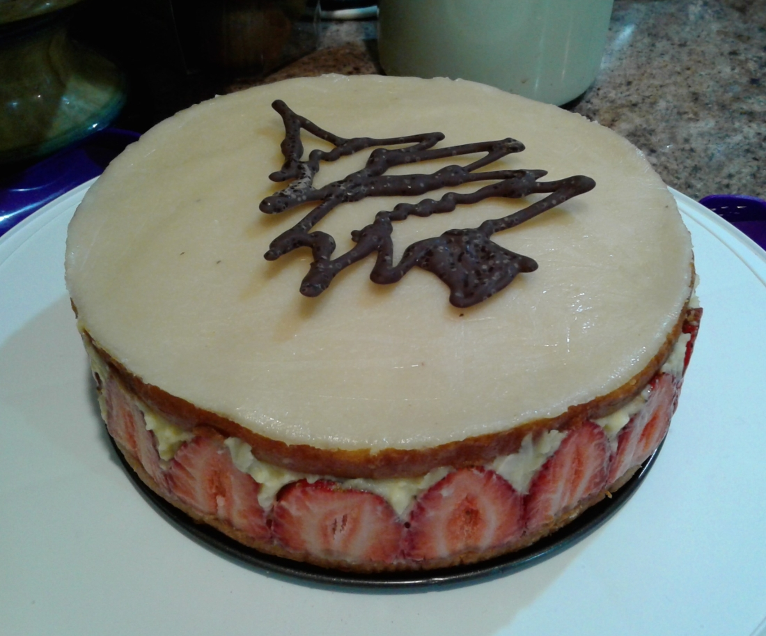 Fraisier cake with lemon syrup soaked sponge, pastry cream, and fresh strawberries