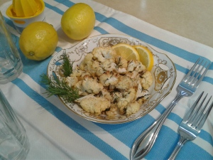 Plate of roasted cauliflower with lemon, garlic, and dill