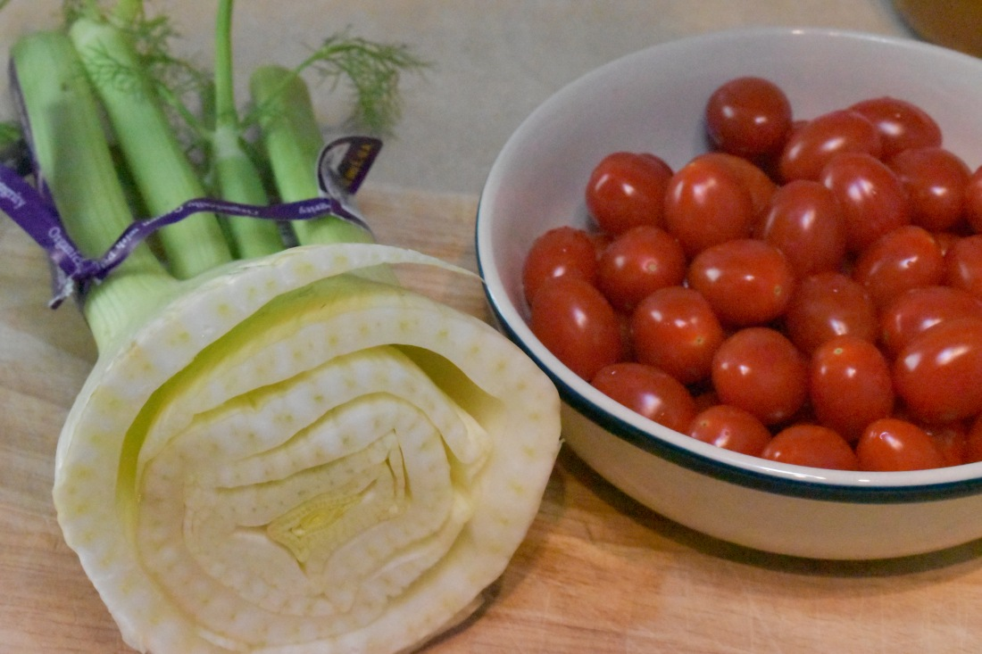 Finocchio fennel and tomatoes on a cutting board
